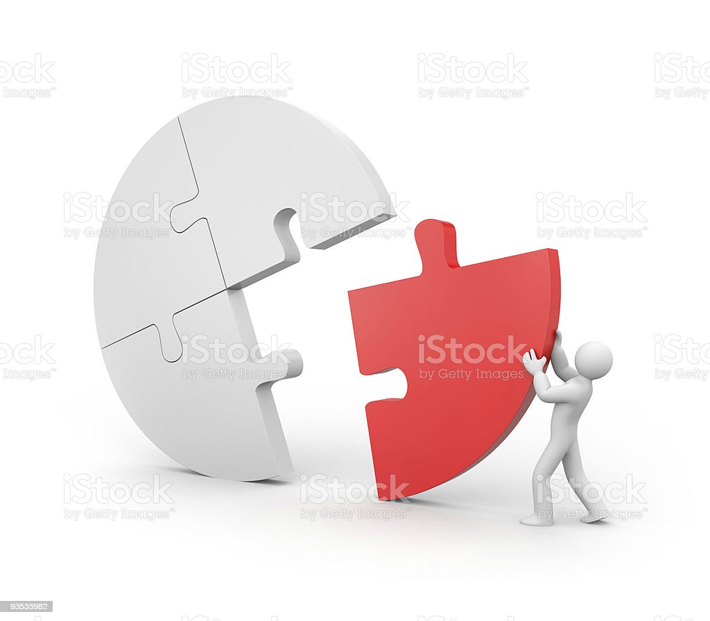 Cartoon toy completing a white puzzle with red missing piece royalty-free stock photo