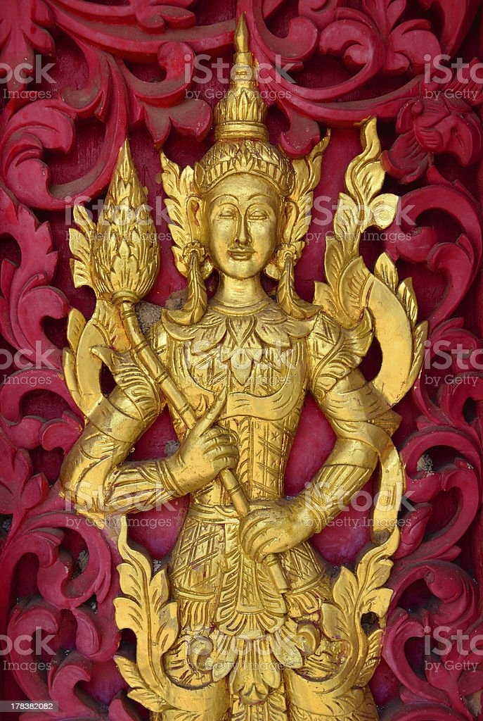 Carved Angel On the Door Of A Temple In Thailand royalty-free stock photo