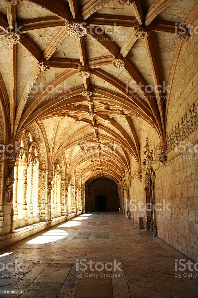 Carved arched corridor in monastery Jeronimos, Lisbon, Portugal stock photo