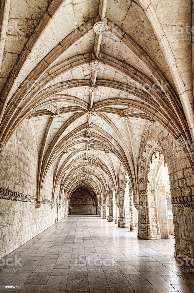 Carved arched corridor in monastery stock photo