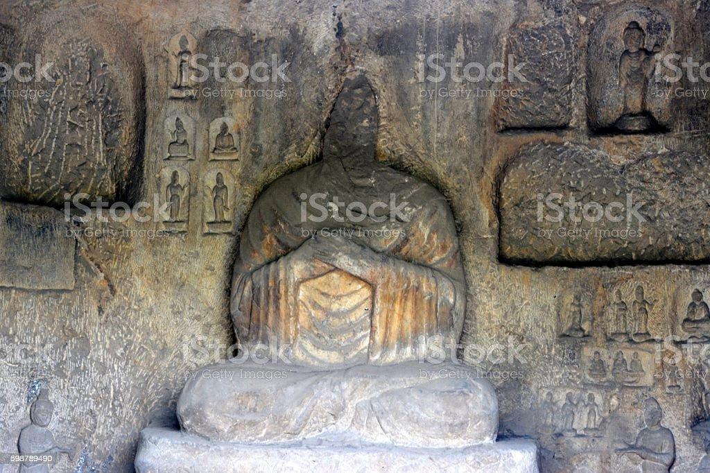 Carved Buddha image at Longmen Grottoes, Luoyang, Henan stock photo