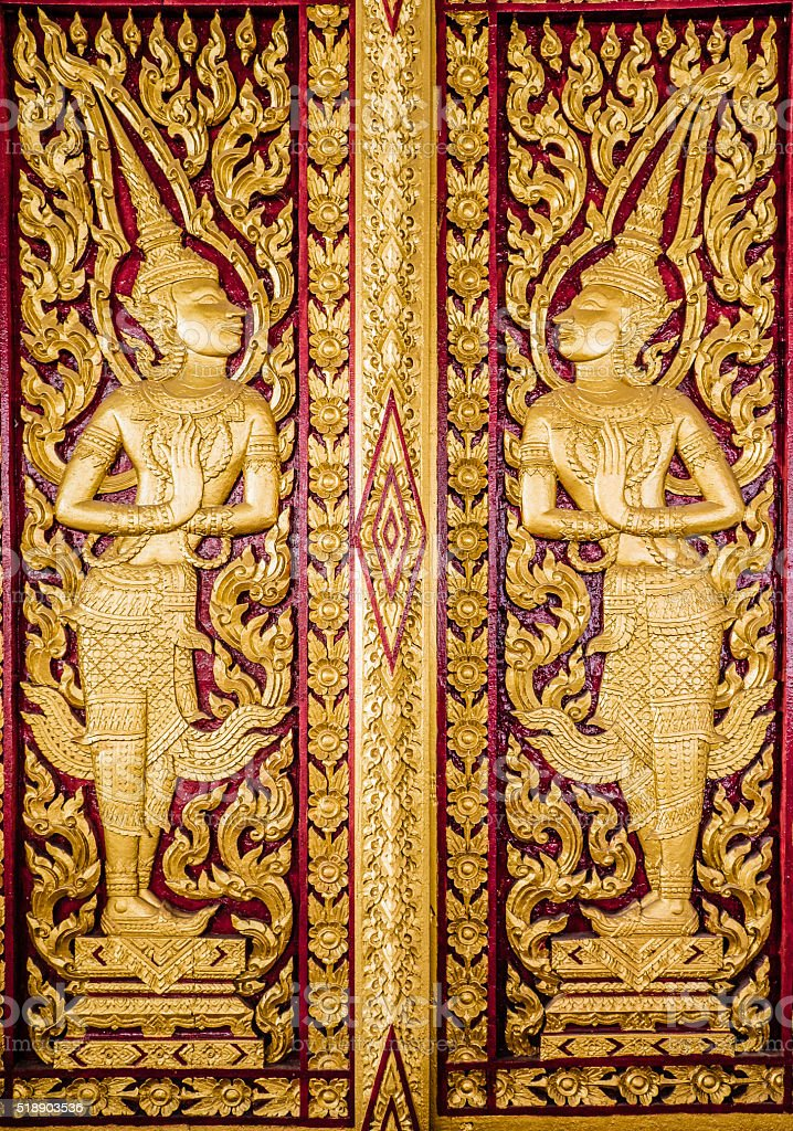 Carved door at Wat Tuek temple stock photo