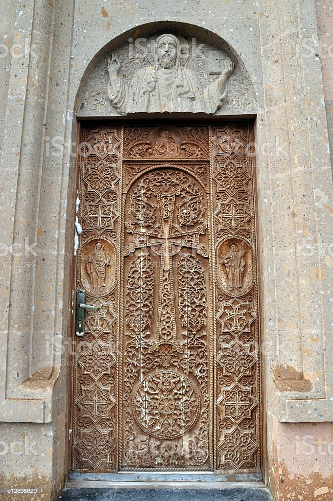 carved door to the church. Armenia stock photo