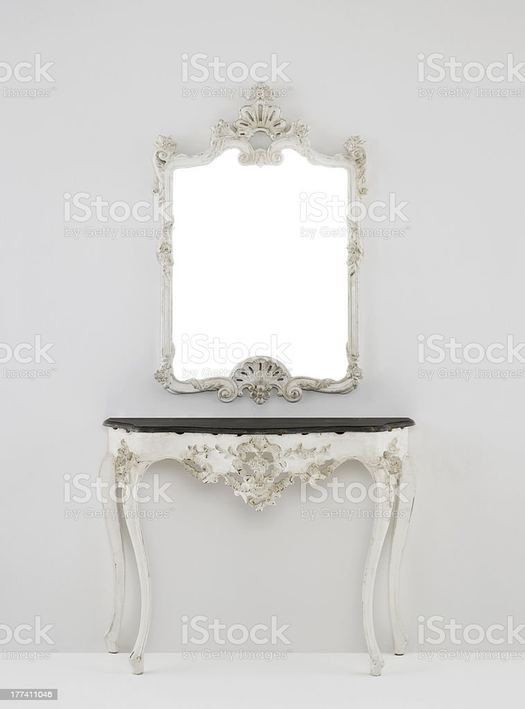 Carved dressing table (chest) in antique style with mirror stock photo