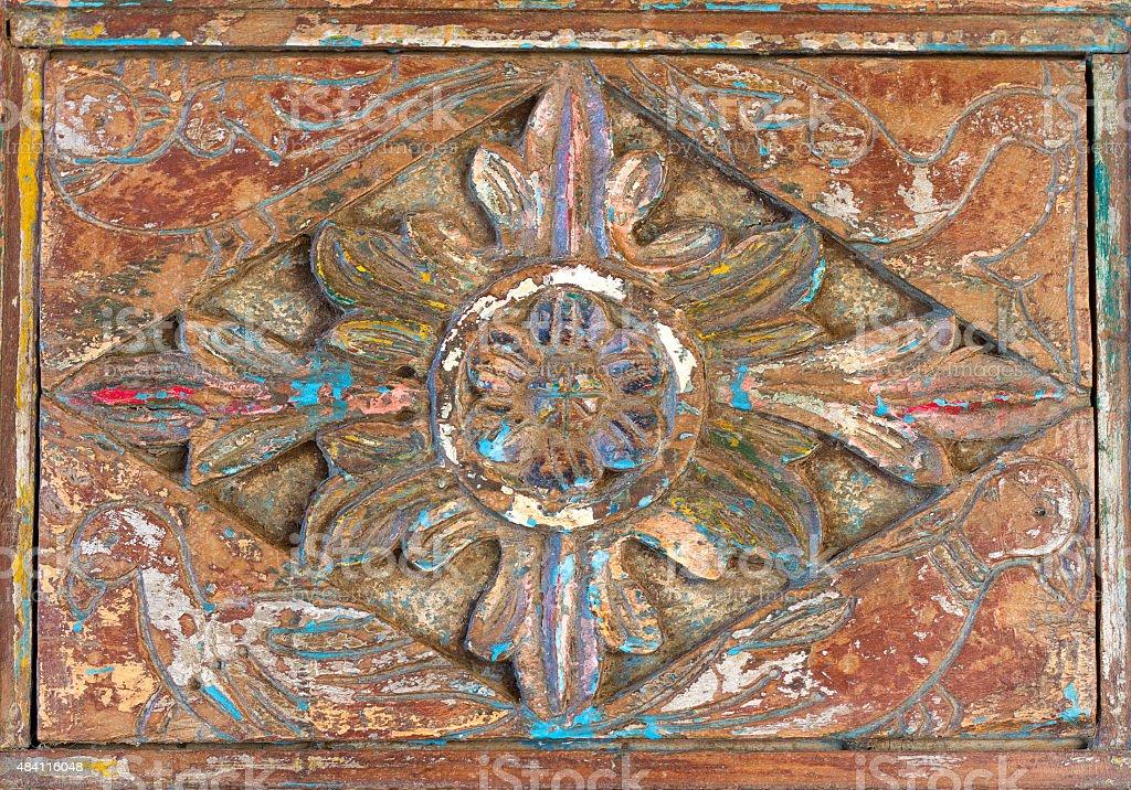 Carved Floral-Bird Door Panel on Antique Indian Door stock photo