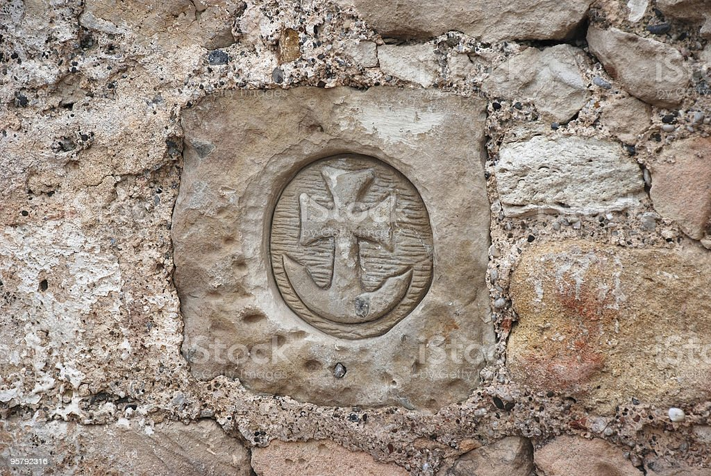 Carved in stone symbols of the ancient ruins royalty-free stock photo