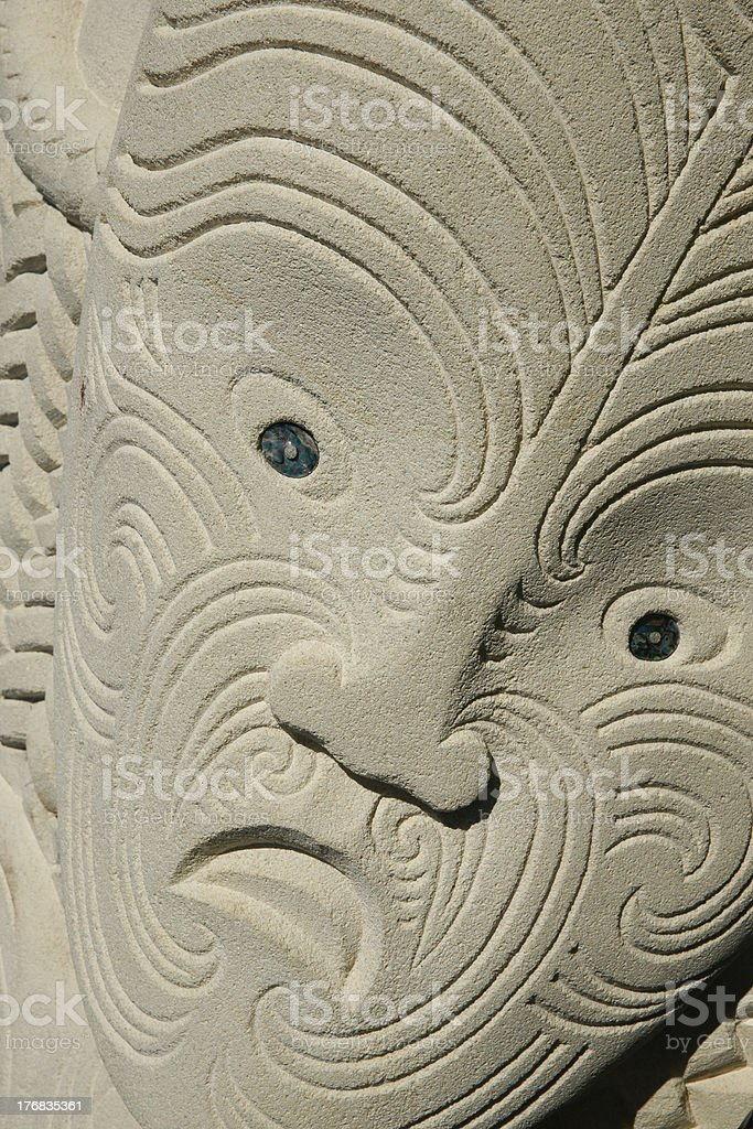 Carved indigenous head, in sanstone. stock photo