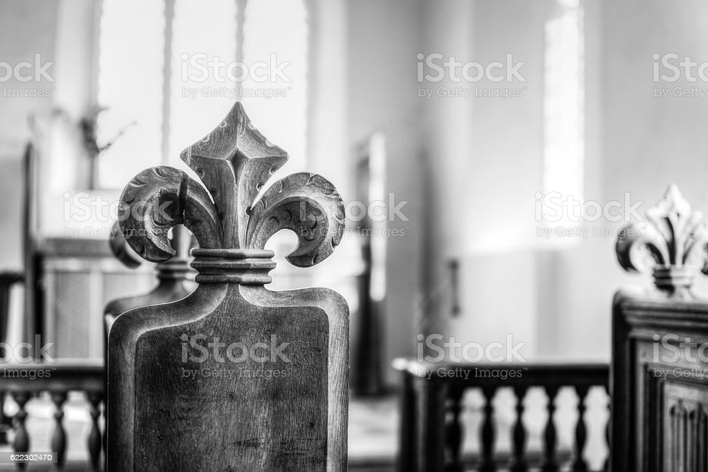Carved Poppy Head Bench in Medieval English Church HDR BW stock photo