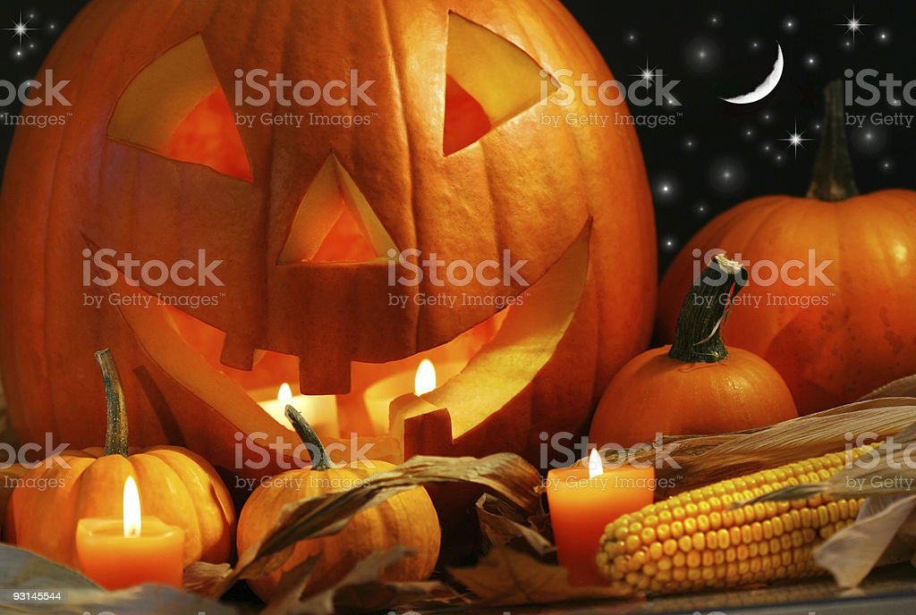 Carved pumpkin with candles stock photo