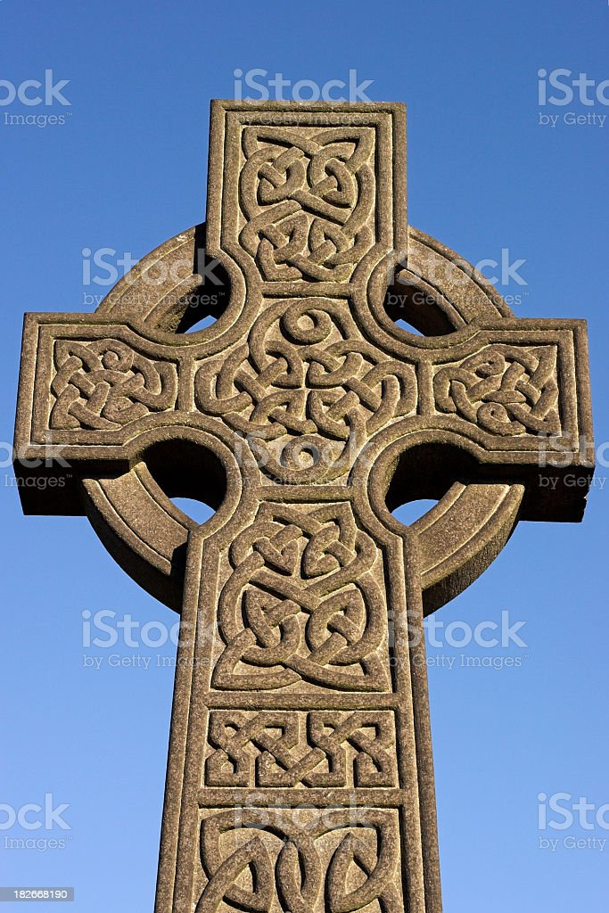 carved stone cross with celtic design stock photo