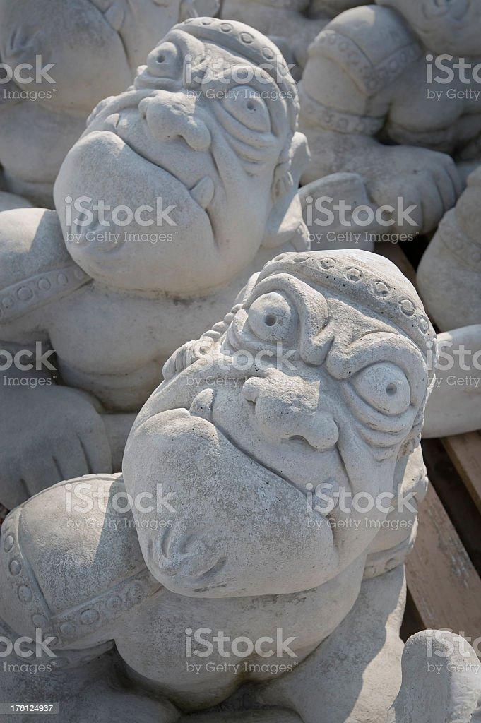 Carved Stone Garden Ogres stock photo