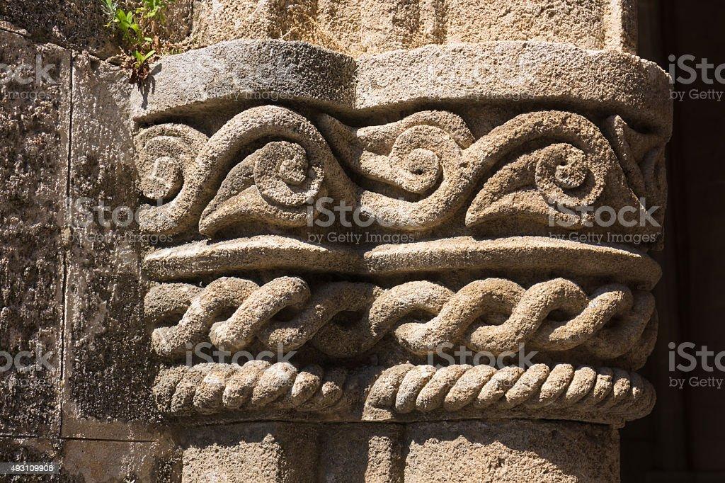 carved stone pillar detail stock photo