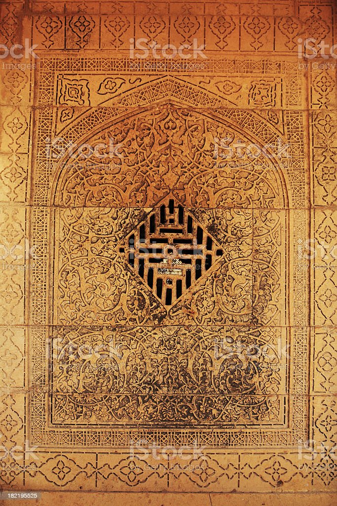 Carved Stone Wall with a window at Makli Necropolis stock photo