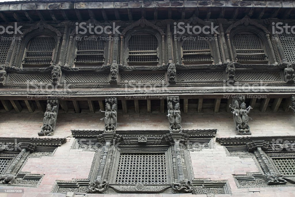 Carved wall of a temple, Katmandu, Nepal royalty-free stock photo