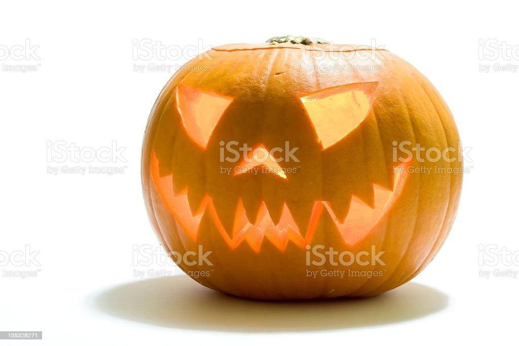 Carved Wicked Halloween Pumpkin Lantern stock photo