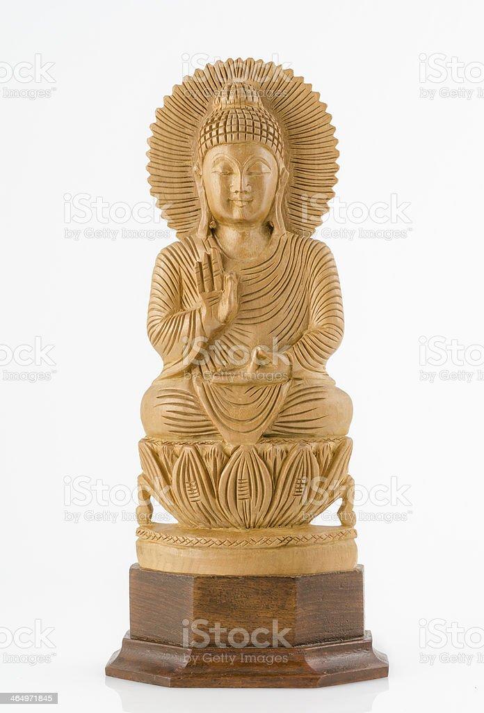Carved Wooden Buddha isolated on white background. stock photo