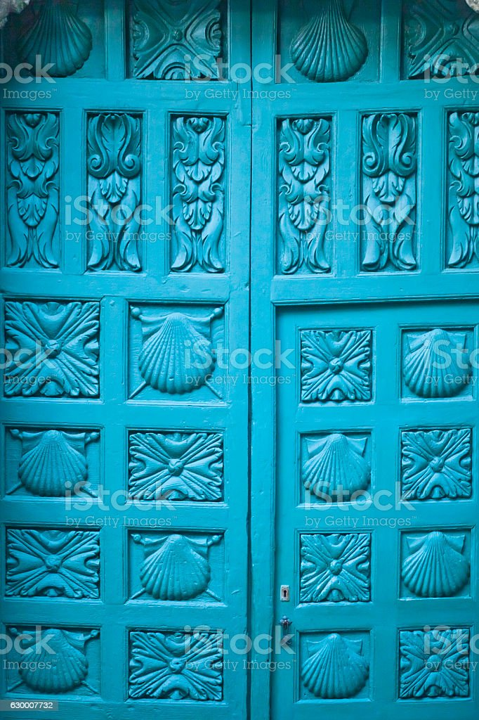 Carved wooden door of the Church of St. James, Ribadavia. stock photo