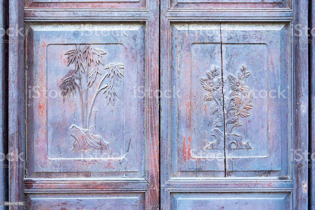 Carved wooden door pannel stock photo