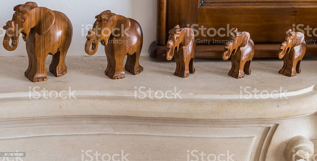 Carved wooden elephants on pedestal stock photo
