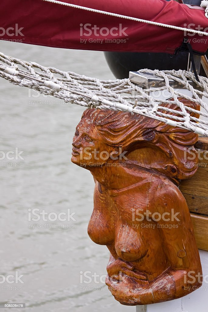 Carved wooden figurehead on a sailing ship UK stock photo
