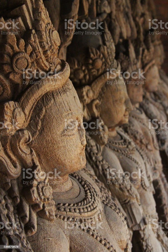 Carved wooden roof beams in Nepal stock photo