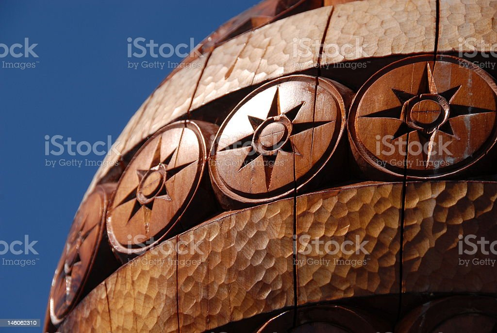 Carved wooden sphere stock photo