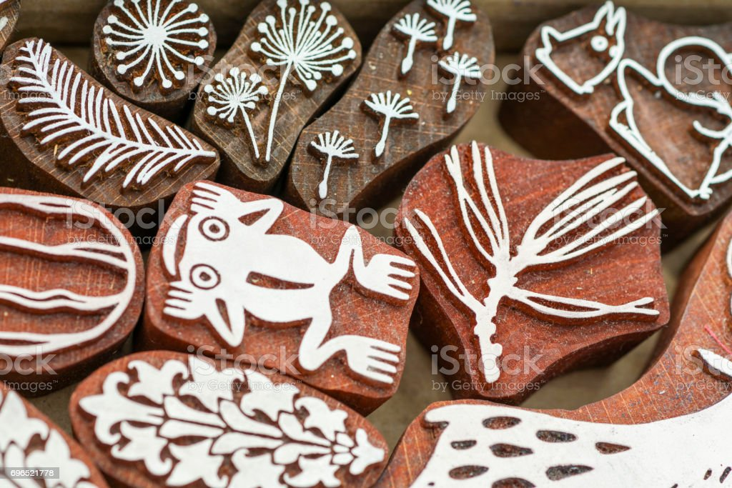 carved wooden stamps of various designs stock photo
