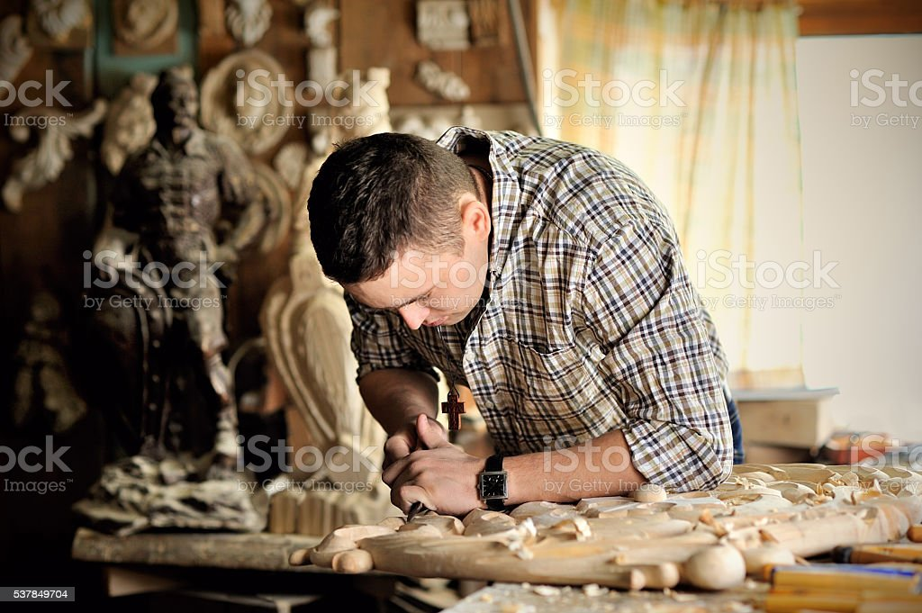 carver working in his workshop stock photo