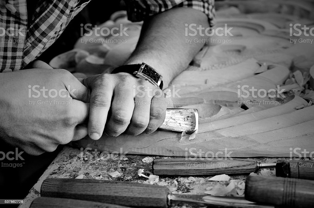 carvers Hands work with chisel in workshop stock photo