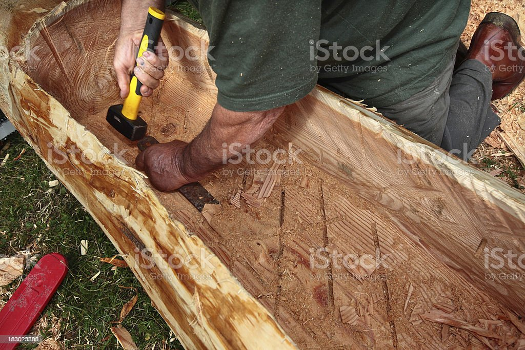 Carving a canoe royalty-free stock photo