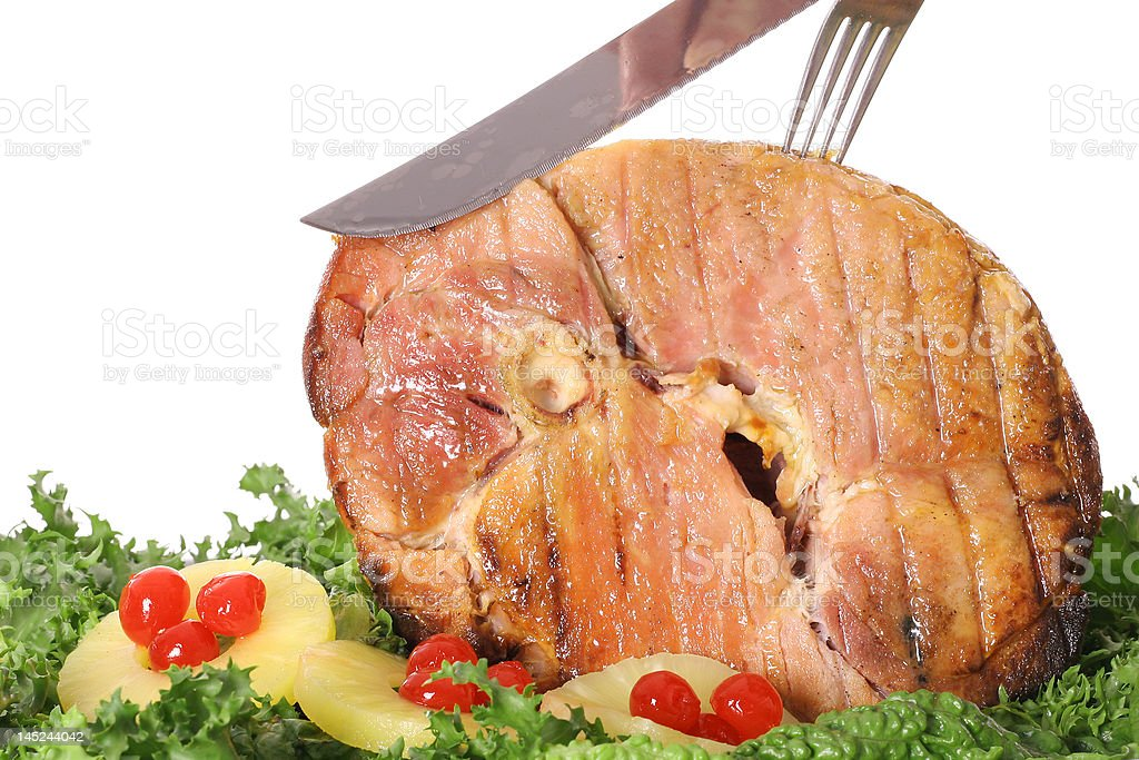 carving a gorgeous ham stock photo