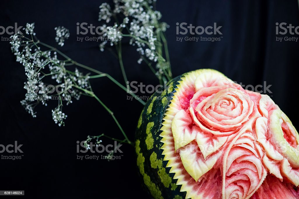 carving, flowers carved into a watermelon stock photo