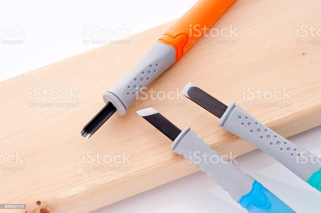 Carving knife with wood stock photo