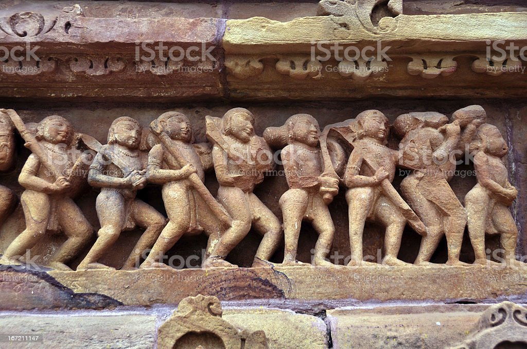 Carving of ancient worriors on the battle field stock photo