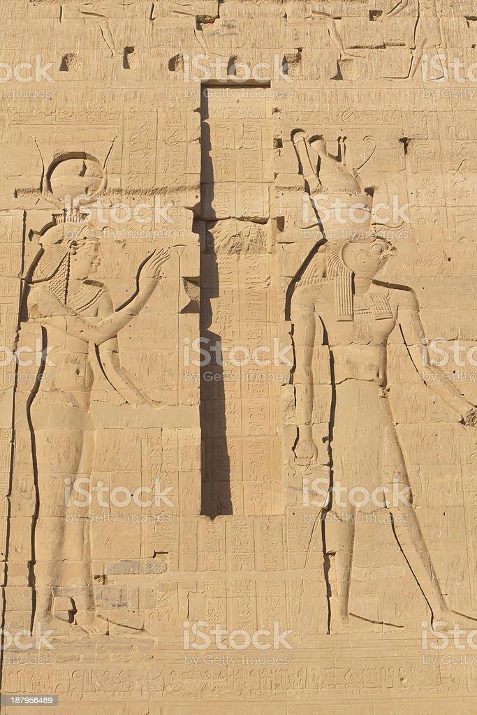 Carving of Egyptian god on pylon (Island  Philae, Egypt) stock photo