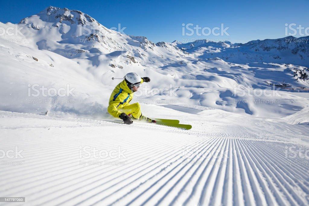 carving on groomed ski run stock photo