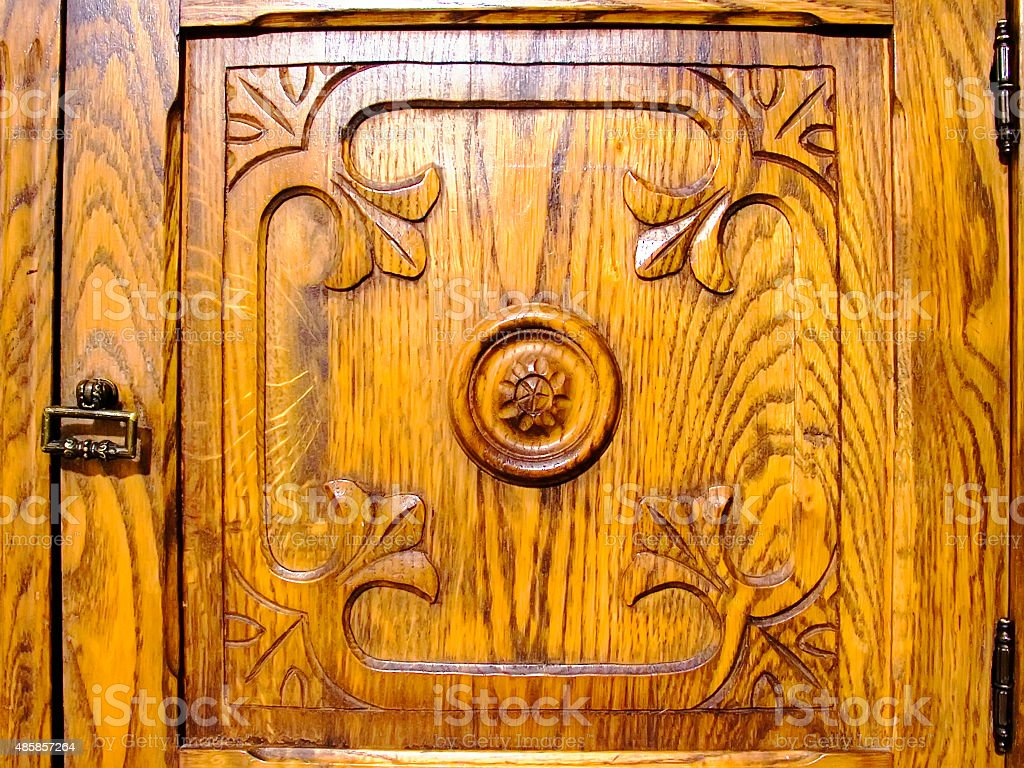 Carving on the door of the cupboard stock photo