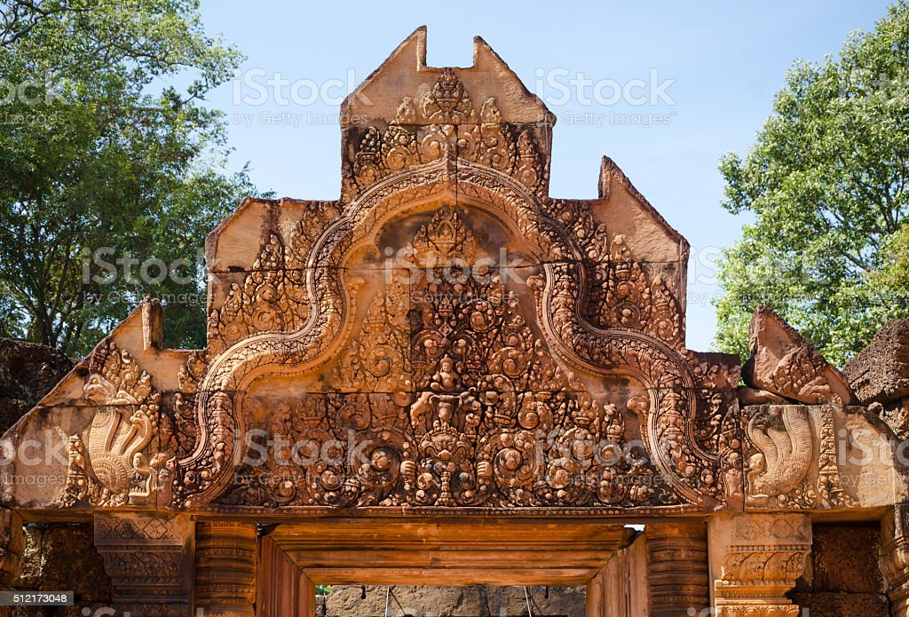 Carving on top of the main entrance at Banteay Srei stock photo