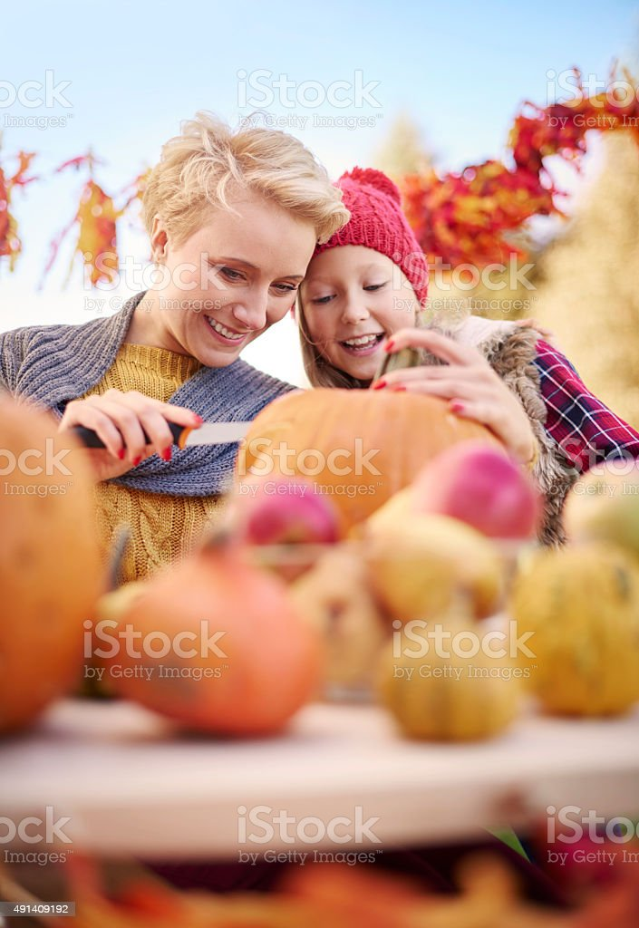 Carving pumpkins is not an easy thing stock photo