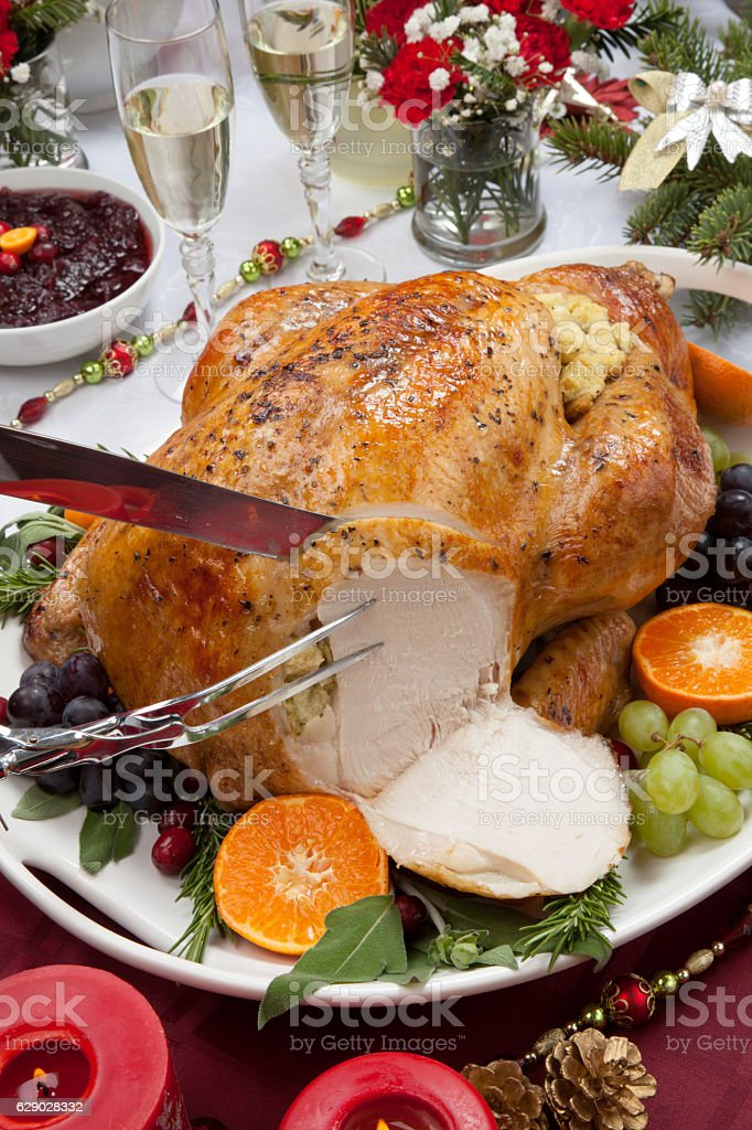 Carving Roasted Turkey for Christmas Dinner stock photo