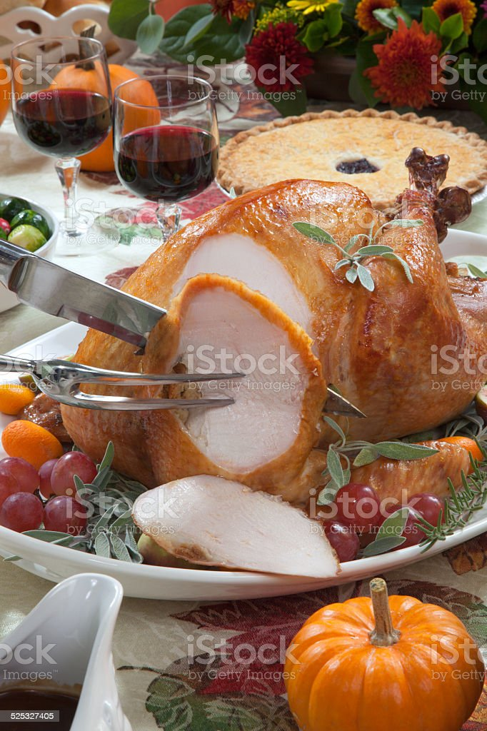 Carving Roasted Turkey on Harvest Table stock photo