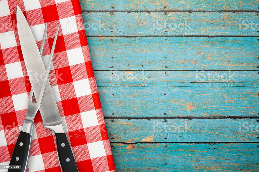 Carving Set of Fork and Knife on Blue Rustic Background stock photo
