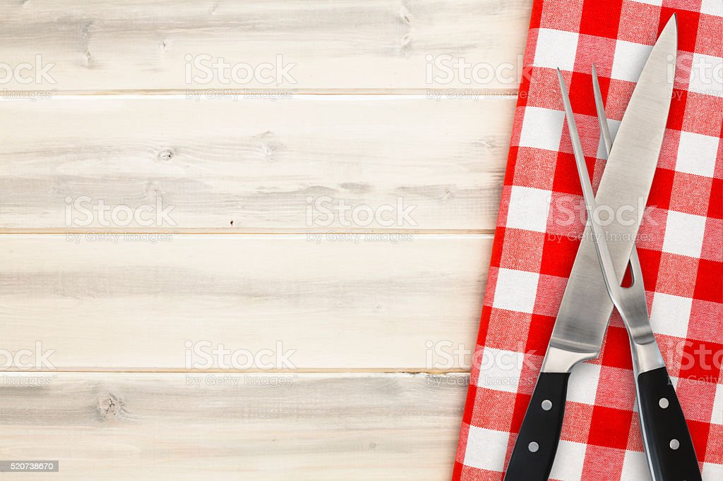 Carving Set of Fork and Knife on White Rustic Background stock photo