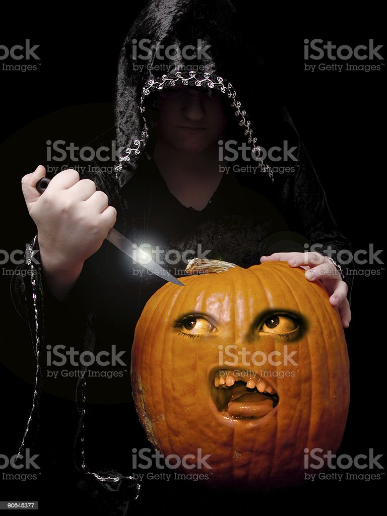 Carving the Pumpkin stock photo