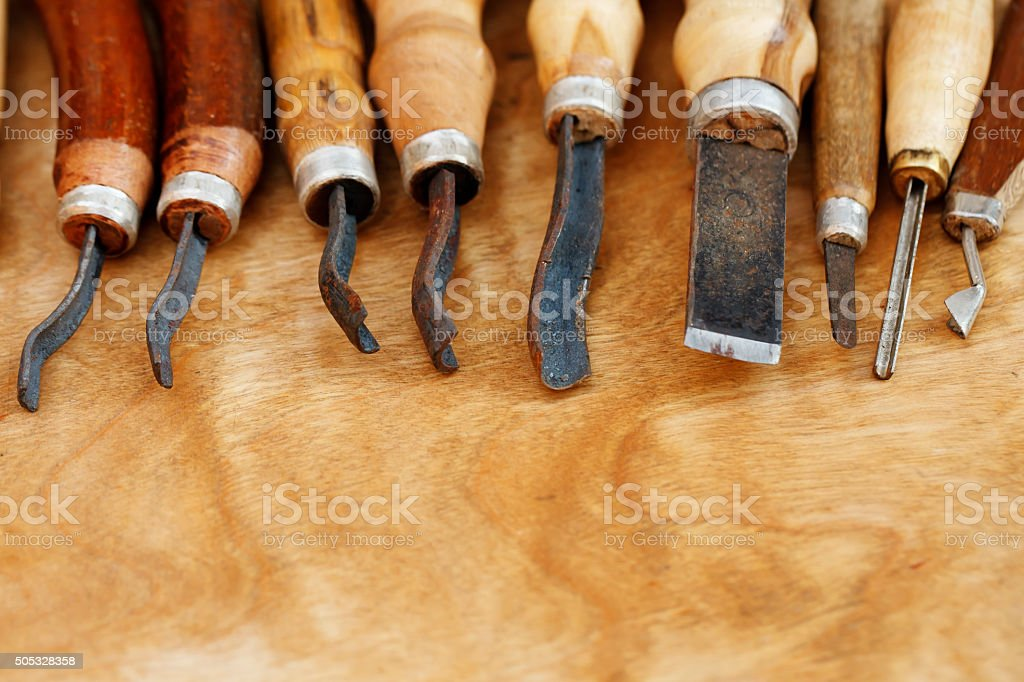 carving tool closeup on wooden background stock photo