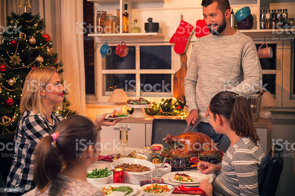 Carving Traditional Stuffed Turkey For Christmas stock photo