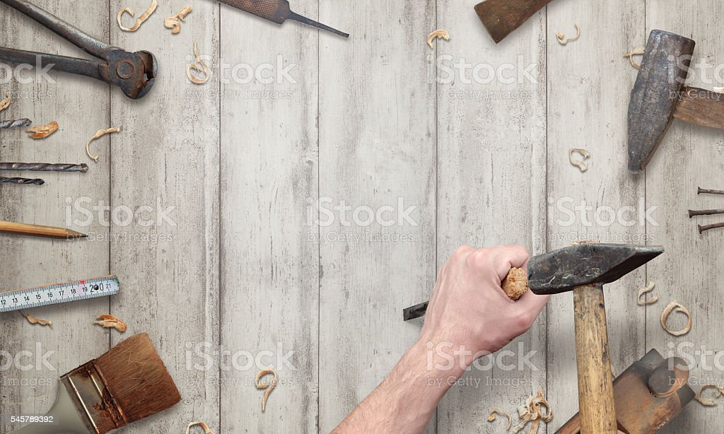 Carving with a chisel on wooden surface. stock photo