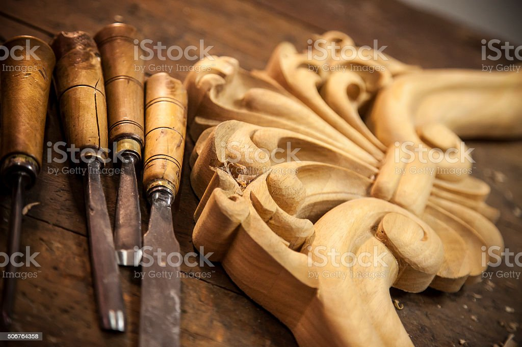 Carving wood - Carpenter's chisel stock photo