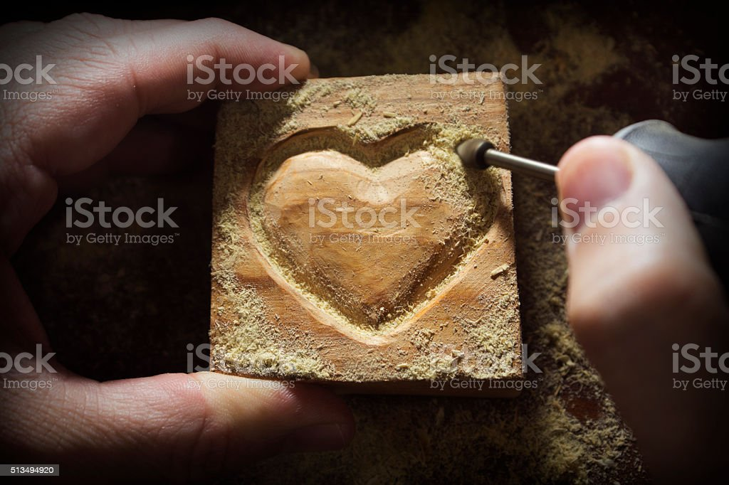 Carving wood in heart shape stock photo