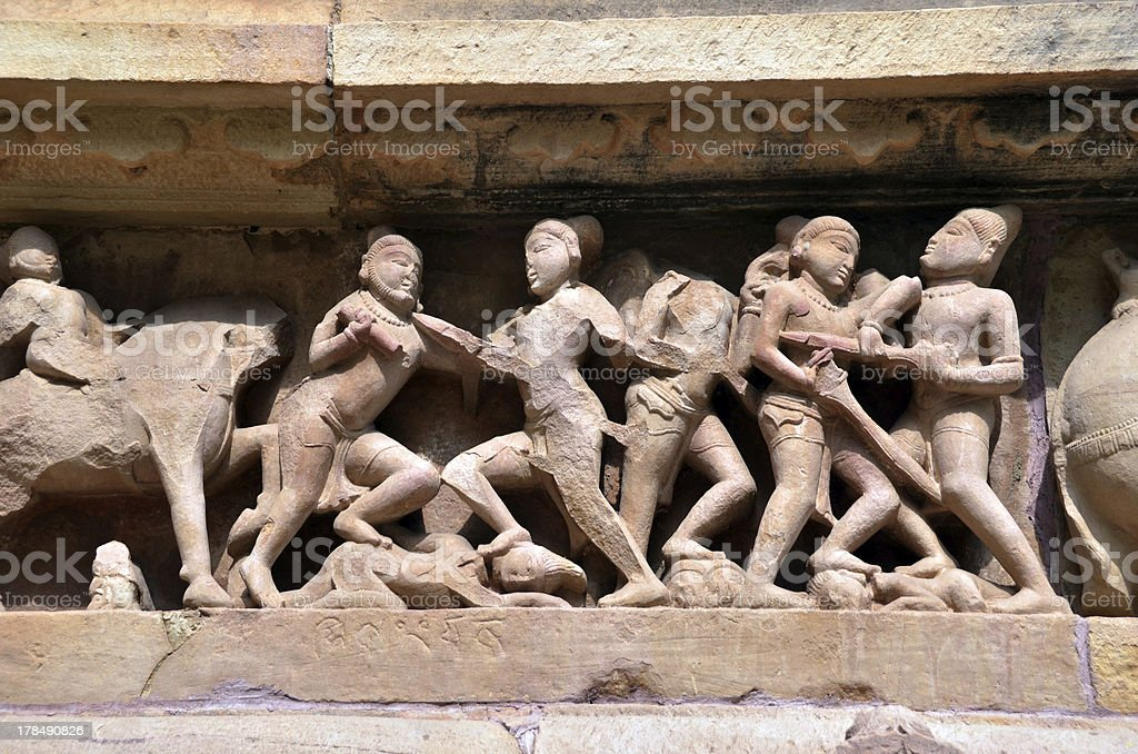 Carvings of ancient warriors on the battle field stock photo